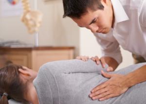 chiropractor making adjustment